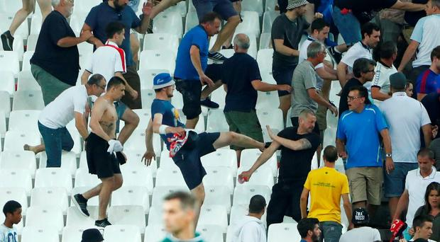 England fans try to escape trouble in the stadium at full time