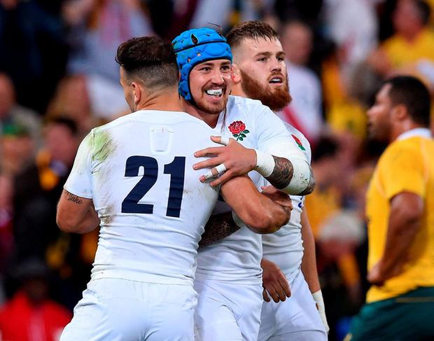 England's Jack Nowell celebrates with teammates after defeating Australia in their rugby union test match in Brisbane. Photo: Dave Hunt/AAP Image via AP