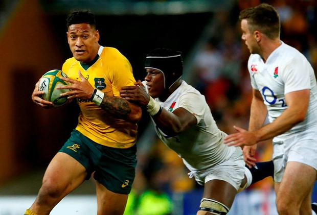 Australia's Israel Folau makes a run against England's Maru Itoje before scoring a try during the second half. Photo: Jason O'Brien/Reuters