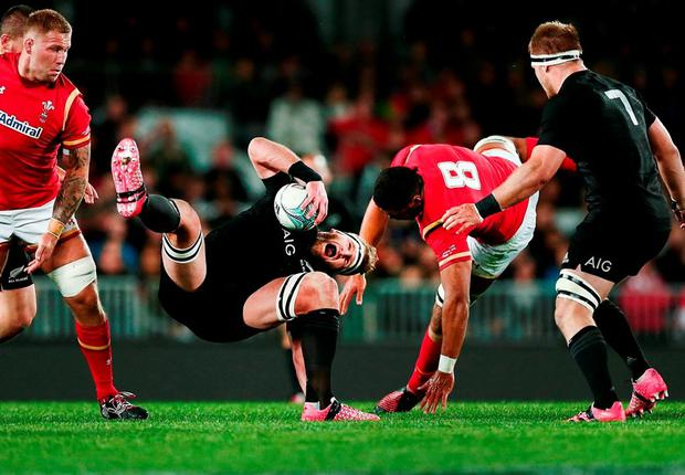 New Zealand's Kieran Read clashes with Wales' Taulupe Faletau going after a high ball. Photo: Anthony Au-Yeung/Getty Images