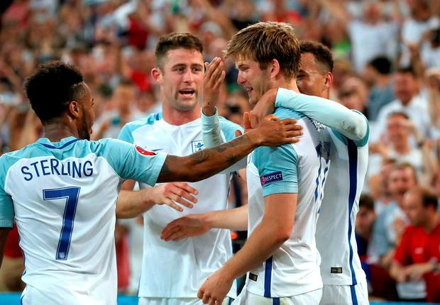 England's Eric Dier (second right) celebrates scoring their first goal