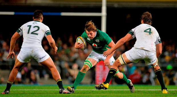 Jordi Murphy takes on Damian de Allende, left, and Eben Etzebeth. Photo:Sportsfile