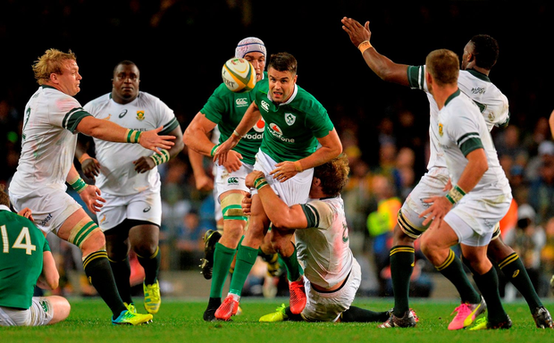 Conor Murray kicks through as he is tackled by Duane Vermeulen. Photo: Brendan Moran/Sportsfile