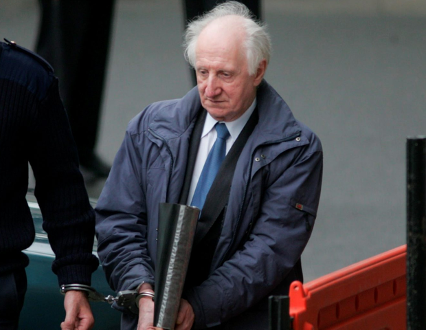 Eamon Cooke is lead away to prison after being convicted of child sex abuse