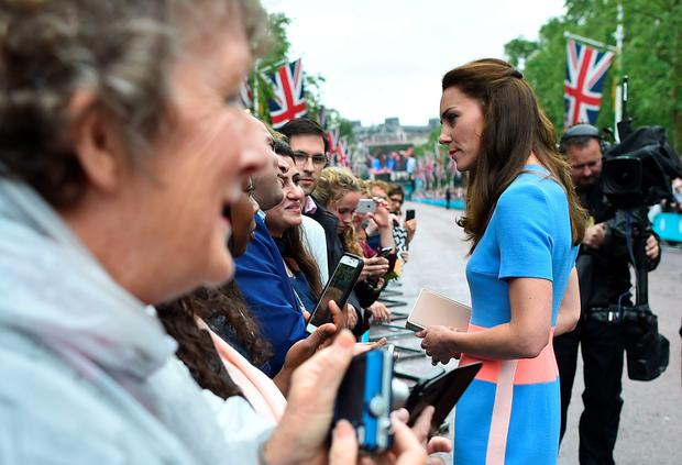 Britain's Catherine, Duchess of Cambridge meets guests at the Patron's Lunch, a special street party outside Buckingham Palace in London on June 12, 2016, as part of the three day celebrations for Queen Elizabeth II's official 90th birthday. / AFP PHOTO / BEN STANSALLBEN STANSALL/AFP/Getty Images