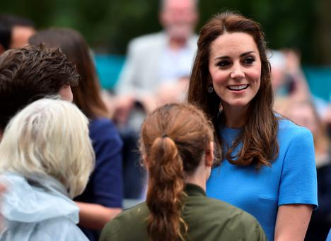 Britain's Catherine, Duchess of Cambridge meets guests at the Patron's Lunch, a special street party outside Buckingham Palace in London on June 12, 2016. / AFP PHOTO / BEN STANSALLBEN STANSALL/AFP/Getty Images