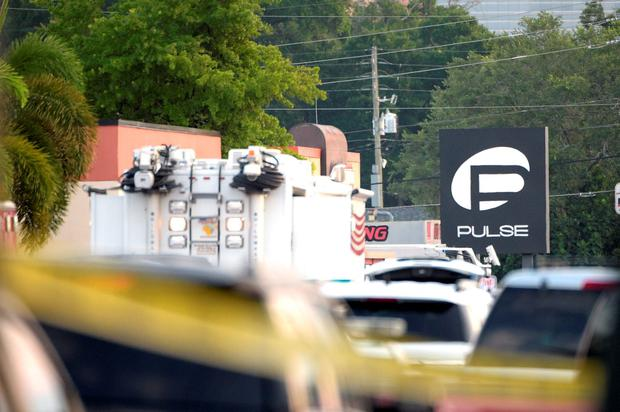 Police cars and emergency vehicles surround the Pulse Orlando nightclub, the scene of a fatal shooting, in Orlando, Fla., Sunday, June 12, 2016