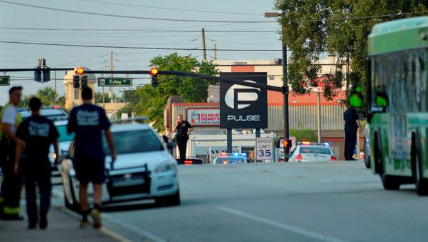 Police lock down Orange Avenue around Pulse nightclub, where people were killed by a gunman in a shooting rampage in Orlando, Florida June 12, 2016.