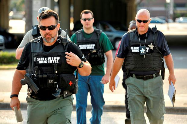 Officers arrive at the Orlando Police Headquarters. Photo: Reuters