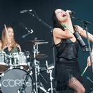 Caroline Corr (left) and Andrea Corr of the Corrs perform on stage at the Isle of Wight Festival, in Seaclose Park, Newport, Isle of Wight. PRESS ASSOCIATION Photo. Picture date: Saturday June 11, 2016.