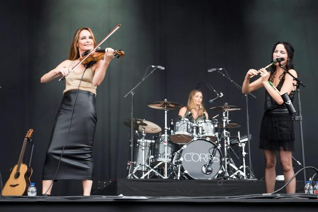 (left to right) Sharon Corr, Caroline Corr and Andrea Corr of the Corrs perform on stage at the Isle of Wight Festival, in Seaclose Park, Newport, Isle of Wight. PRESS ASSOCIATION Photo. Picture date: Saturday June 11, 2016. Photo: David Jensen/PA Wire