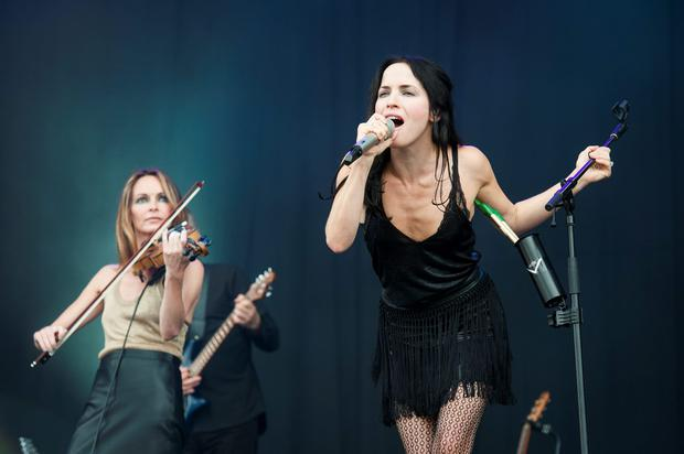 Sharon (left) and Andrea Corr of the Corrs perform on stage at the Isle of Wight Festival, in Seaclose Park, Newport, Isle of Wight. PRESS ASSOCIATION Photo. Picture date: Saturday June 11, 2016. Photo credit: David Jensen/PA Wire