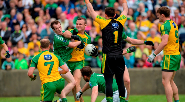 Neil McGee of Donegal clashes with Ruairi Corrigan of Fermanagh