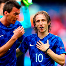 PARIS, FRANCE - JUNE 12: Luka Modric (R) and Mario Mandzukic (L) of Croatia celebrate their team's 1-0 win in the UEFA EURO 2016 Group D match between Turkey and Croatia at Parc des Princes on June 12, 2016 in Paris, France. (Photo by Clive Rose/Getty Images)