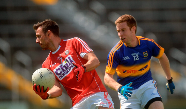 Kevin O'Driscoll of Cork in action against Brian Fox of Tipperary