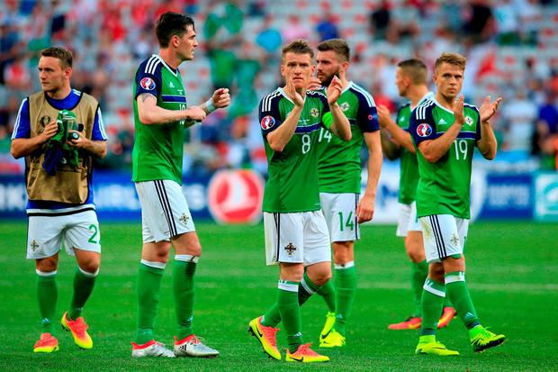 Northern Ireland's Steven Davis (centre) applauds the fans