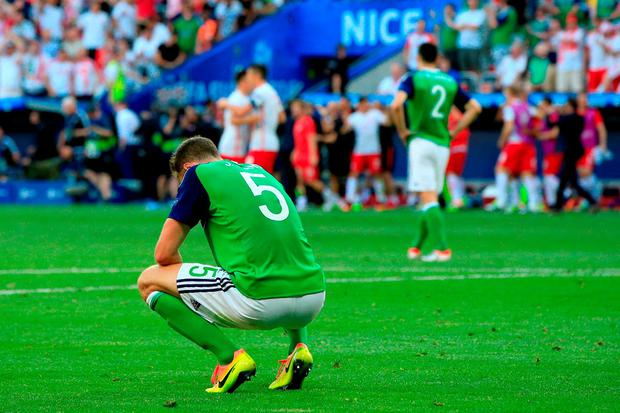 Northern Ireland's Jonny Evans shows his dejection after the final whistle