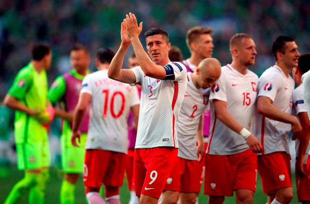 Poland's Robert Lewandowski applauds the fans