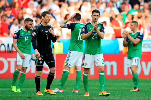 Northern Ireland's players react after their loss during the Euro 2016 group C football match between Poland and Northern Ireland at the Allianz Riviera stadium in Nice on June 12, 2016. / AFP PHOTO / Valery HACHEVALERY HACHE/AFP/Getty Images