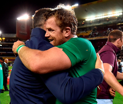 Jamie Heaslip embraces Ireland defence coach Andy Farrell, who has to take huge credit for the performance. Photo: Brendan Moran/Sportsfile