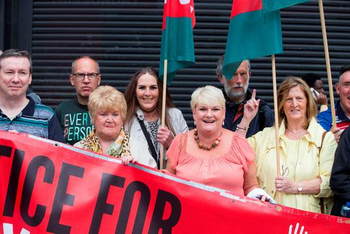 Clerys workers who lost their jobs when the store closed one year ago rally outside the store. Photo: Fergal Phillips
