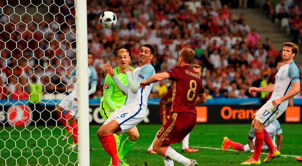 Joe Hart and Chris Smalling can only look on as Vasili Berezutski scores Russia's equaliser. Photo: Laurence Griffiths/Getty Images