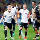 Germany's Bastian Schweinsteiger celebrates with team mates after scoring their second goal. REUTERS/Carl Recine