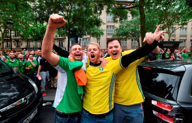 Ireland fans enjoy themselves with their Swedish counterparts in Montmatre. Photo: Sportsfile