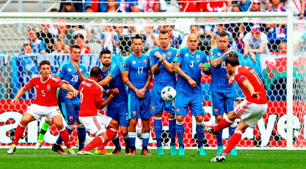 Gareth Bale of Wales scores his team's first goal from a free kick during the UEFA EURO 2016 Group B match between Wales and Slovakia. Photo: Dean Mouhtaropoulos/Getty Images