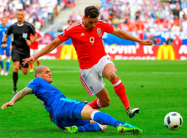 Slovakia's defender Martin Skrtel vies for the ball with Wales' forward Hal Robson-Kanu during the Euro 2016 group B football match between Wales and Slovakia. Photo: Joe Klamar/Getty Images