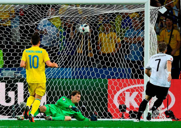 Germany's midfielder Bastian Schweinsteiger scores a goal during the Euro 2016 Group C football match between Germany and Ukraine. Photo: Martin Bureau/Getty Images