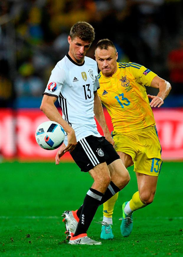 Ukraine's defender Vyacheslav Shevchuk challenges Germany's Thomas Mueller during the match between Germany and Ukraine. Photo: Martin Bureau/Getty Images