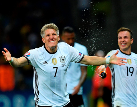 Germany's midfielder Bastian Schweinsteiger celebrates with teammates after scoring a goal during the match between Germany and Ukraine6. Photo: Martin Bureau/Getty Images