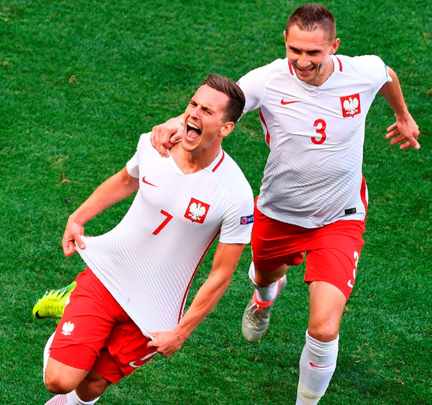 Poland's forward Arkadiusz Milik celebrates after scoring a goal during the match between Poland and Northern Ireland. Photo: Boris Horvat/Getty Images