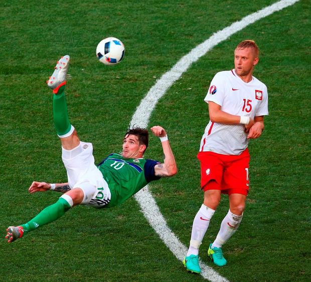 Kyle Lafferty of Northern Ireland attempts an overhead kick during the match between Poland and Northern Ireland. Photo: Alex Livesey/Getty Images