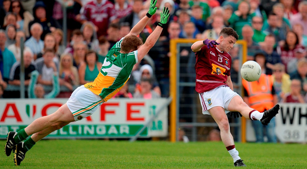 Westmeath's John Connellan kicks a point whilst under pressure from Brian Darby of Offaly during the Leinster SFC quarter-final in Cusack Park. Photo by Seb Daly/Sportsfile