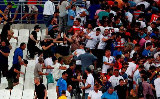 Russian supporters chase England fans out of their seats at Stade Velodrome on Saturday night following their Euro 2016 opener. Photo: Lars Baron/Getty Images
