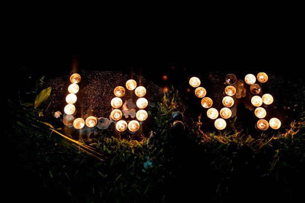 Candles sit on the edge of Lake Eola, June 12, 2016 in Orlando, Florida. The shooting at Pulse Nightclub, which killed 50 people and injured 53, is the worst mass-shooting event in American history. (Photo by Drew Angerer/Getty Images)