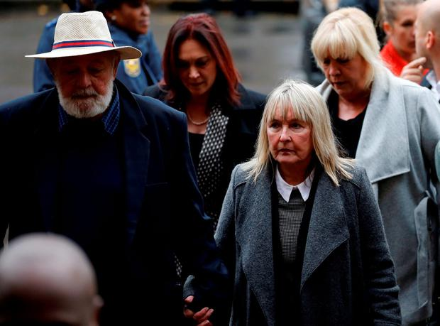 Barry Steenkamp (L), father of Reeva Steenkamp, arrives with his wife June Steenkamp for the sentencing of former Paralympian Oscar Pistorius at the Pretoria High Court