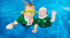 Jade and Daryl McNamara join the Green Army... underwater (Photo: waterbabies.ie)