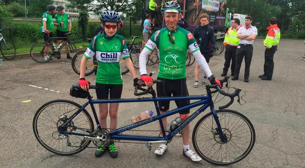 Cahir O'Higgins and his daughter Iseult after completing the last leg of the Mustard Seed Cycle