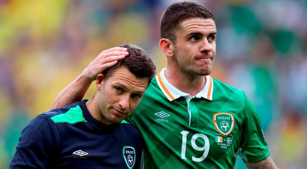 Republic of Ireland's Wes Hoolahan and Robert Brady after the final whistle during the UEFA Euro 2016, Group E match at the Stade de France, Paris. John Walton/PA Wire