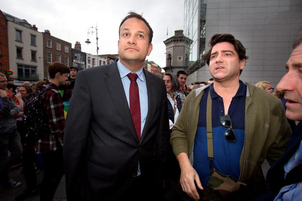 Leo Varadkar, Minister for Social Protection and singer Brian Kennedy at a Rainbow Vigil at Barnado's Square in June to express their solidarity and sympathy with the victims of the Orlando shooting tragedy. Photo: Tony Gavin