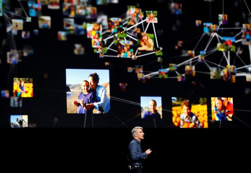 Craig Federighi, Senior Vice President of Software Engineering for Apple Inc., talks about photos within iOS at the company's World Wide Developers Conference in San Francisco, California, U.S. June 13, 2016. Stephen Lam