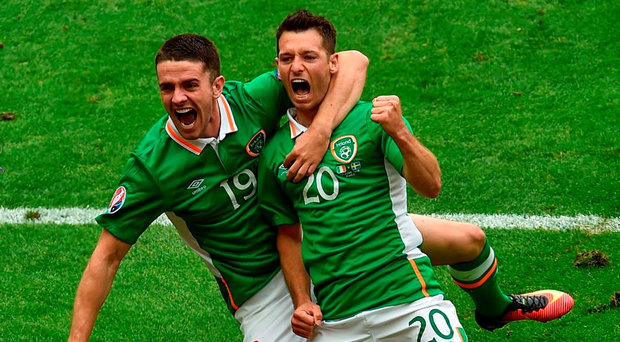Wes Hoolahan celebrates his goal against Sweden with Robbie Brady at the Stade de France. Photo: Paul Mohan/Sportsfile