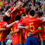Spain's players celebrate after Spain's defender Gerard Pique scored the opening goal during the match. Photo: Nicolas Tucat/Getty Images