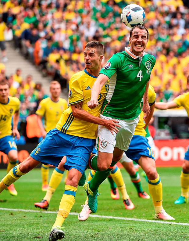 John O'Shea gets in front of Mikael Lustig to win the header. Photo: David Maher/Sportsfile