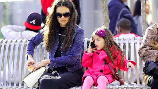 Risky business?: Suri Cruise, the 10-year-old daughter of Tom Cruise and Katie Holmes, seen talking on a mobile phone while out with her mum.