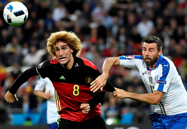 Belgium's midfielder Marouane Fellaini vies for the ball against Italy's defender Andrea Barzagli during the match between Belgium and Italy. Photo: Jeff Pachoud/Getty Images