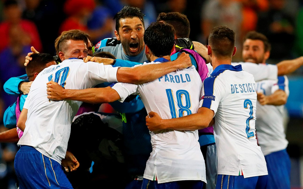 The Italian team celebrate their win over Belgium in Lyon last night. Photo: Reuters/Jason Cairnduff